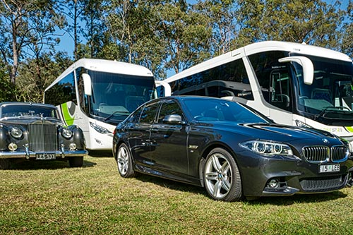 Picture of a few of Lonestars coaches and vehicles ready for use in charters on the Gold Coast